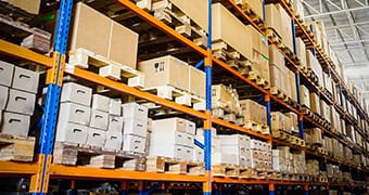 Automotive aftermarket parts packaged in boxes on a pallet racking system