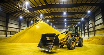 yellow goods wheeled loader in a warehouse